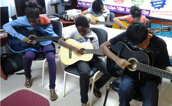 Photo os Students in Guitar Lab